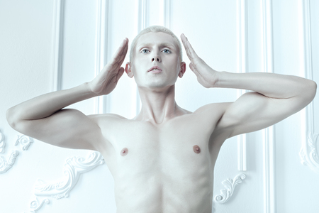 womanlike: Male albino with white skin and blue eyes. Stock Photo