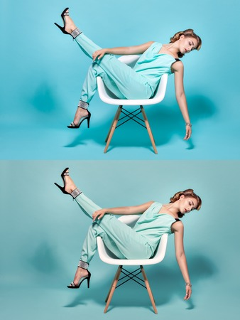 footsie: Elegant and beautiful woman posing sitting on a chair in the Pin-Up style. Stock Photo