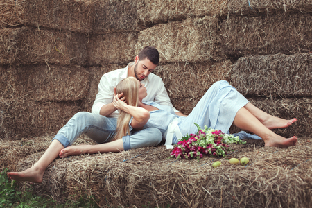 hayloft: Man and woman in the hayloft, they love and flirting.