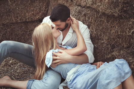 hayloft: Man kissing a woman in the hayloft, they are lovers. Stock Photo