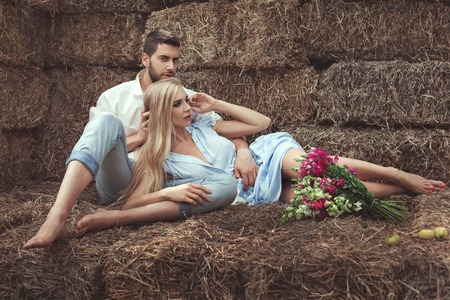 hayloft: Woman lies on the man and dreams, they are in the hayloft in the village.