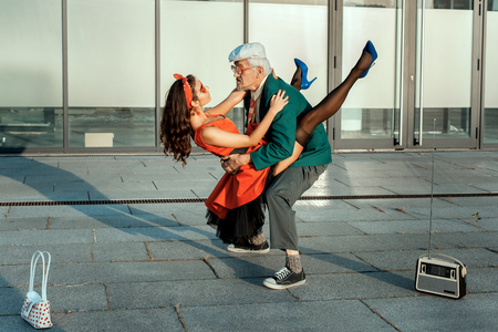 humorously: Old man dance fast dance with a young girl.