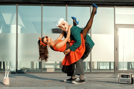 humorously: During the dance, the young girl jumped on the old man.