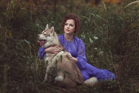 dearness: Girl hugging husky dog, they are in a fairy tale.