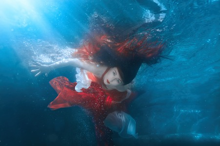 profound: Girl in red dress under water, it is a mermaid.