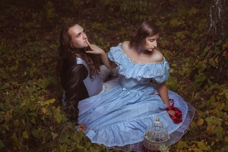 paramour: Girl flirting with a man in the woods, retro style. Stock Photo