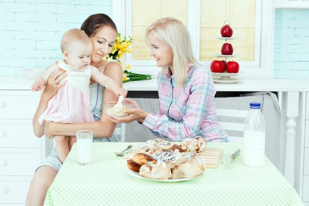 Mom and baby sitter are fed in the kitchen.
