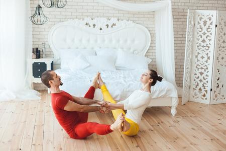Boy and girl gymnasts, they reniruyutsya morning in the bedroom.