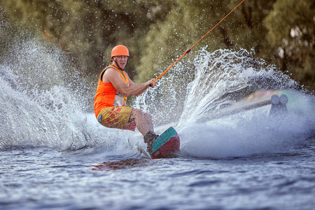 Extreme sport for men, water skiing on the board. Stock Photo