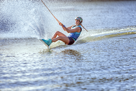 waterskiing: Woman surfs on the water, a summer kind of extreme sports. Stock Photo
