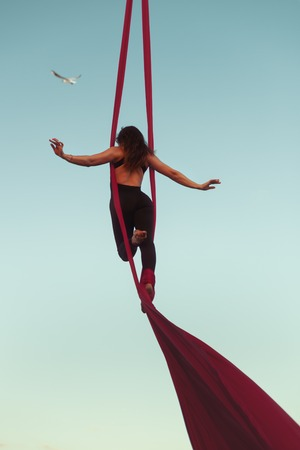 Anti-gravity yoga on the hammock in the air. Stock Photo