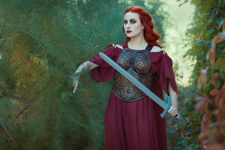 rigidity: Red-haired woman warrior with a sword in her hand, shes a defender.