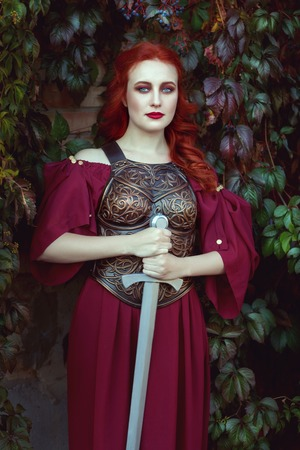 rigidity: Beautiful red-haired woman with a sword in her hands.
