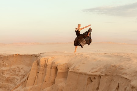 flit: Dancer jumped while dancing, she was in the desert of their sand.