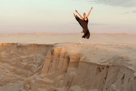 flit: Woman jumped over the abyss in the dance, she shows the performance. Stock Photo
