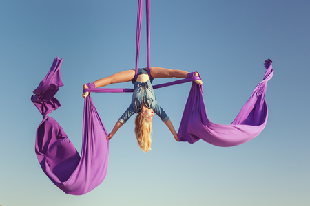 Air acrobat spread her wings, she performs complex figures. Stock Photo