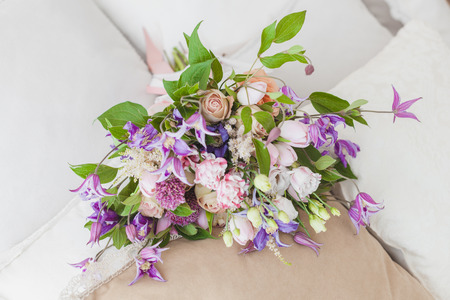 Festive bouquet of flowers, a gift for a lady.