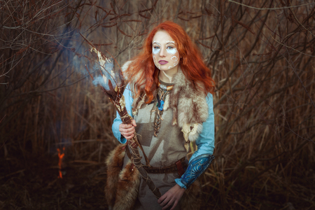 Pagan woman is a shaman during a witchcraft ritual.