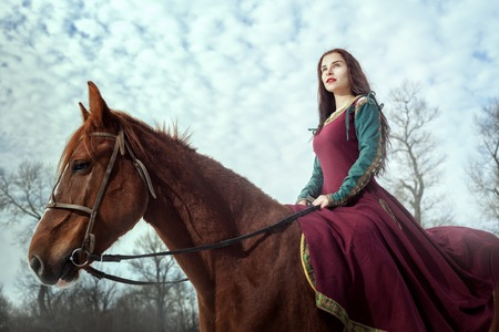 Portrait of a beautiful young woman riding a horse.
