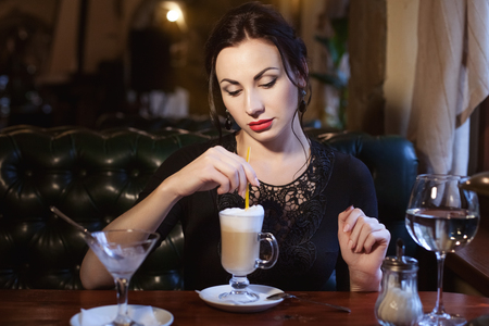 Sad woman drinks coffee and misses lonely in a cafe. Stock Photo