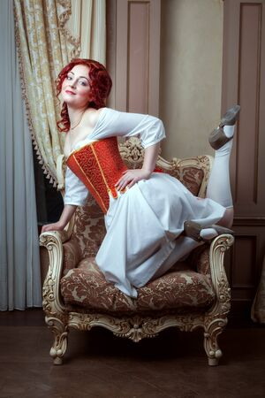 Portrait of a beautiful young woman in a dress and corset in Victorian style. Banque d'images - 129598597