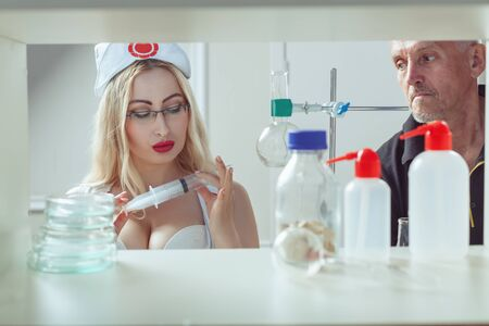 A sick patient was frightened by a syringe. The nurse wants to make a man with a syringe.