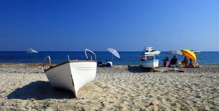 white boats and people on the beach