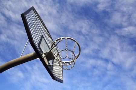 swish: Basketball hoop and backboard set against a blue sky