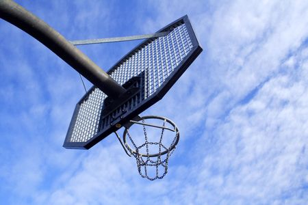 Basketball hoop and backboard set against a blue sky Stock Photo - 2527335