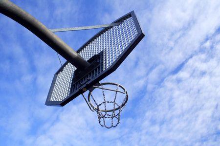 Basketball hoop and backboard set against a blue sky Stock Photo - 2527335
