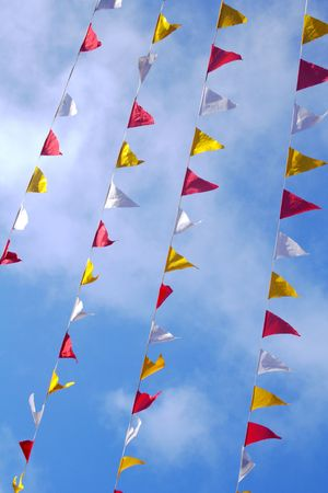 red, white and yellow flags in the street