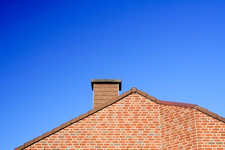 roof with a chimney with blue sky