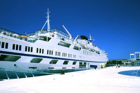 cruise ship anchored in a pier photo