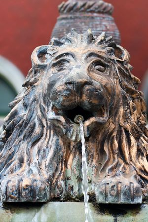 swelter: lion fountain from brass in a swelter Stock Photo