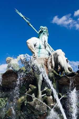neptun fountain with blue sky in Berlin photo