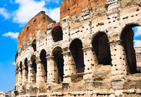 the colosseum with blue sky, Rome, Italy photo
