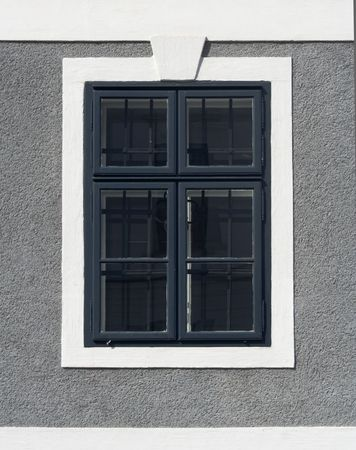 window on a house with gray wall photo