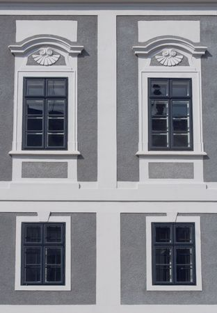 pane: windows on a house with gray wall Stock Photo