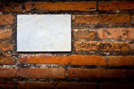 blank gray board on a brick wall