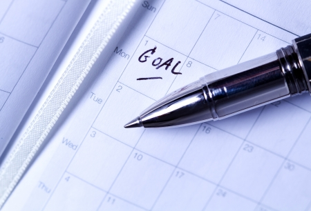 pen put on diary that writed  GOAL  letter Stock Photo