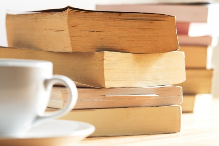 cofffee: pile of book on the table close up