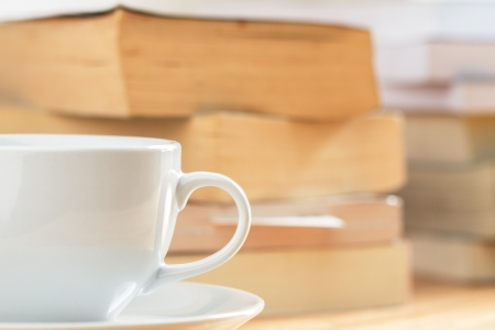 cofffee: coffee cup with pile of book