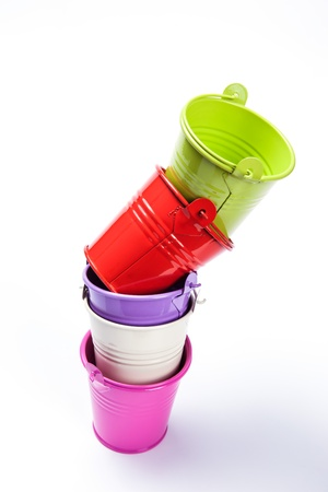 matallic: colorful bucket stack onwhite background Stock Photo
