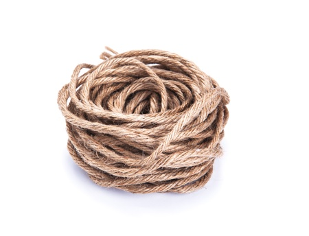 coiled rope: small rope coiled on white background
