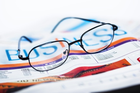 eyeglasses on newspaper close up photo