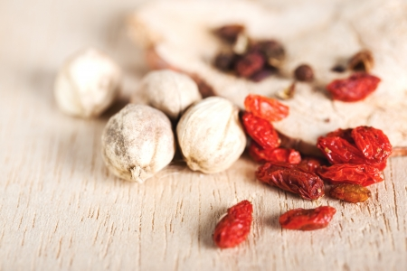 dry goji berries and coriander seed close up photo