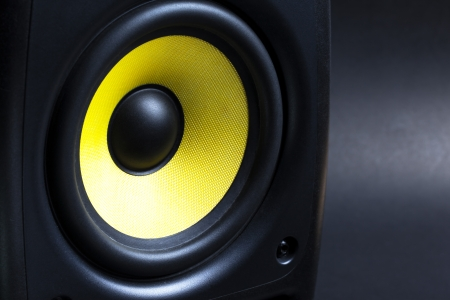 audio speaker on black background close up photo