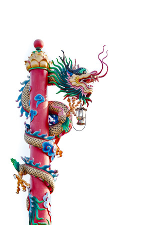 chinese dragon statue with lamb on the pole photo