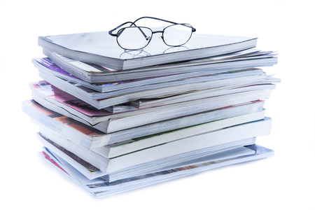 magazine and book stack with glasses  photo