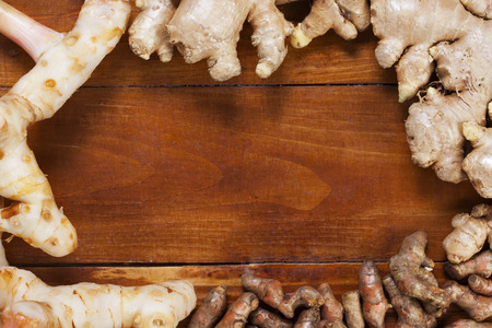 galangal: ginger,galangal and curcuma longa on wood Stock Photo